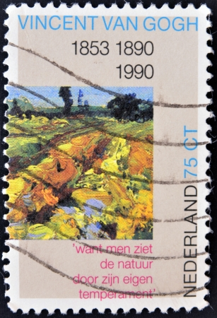 HOLLAND - CIRCA 1990: A stamp printed in the Netherlands shows The Green Vineyard, Detail of Painting by Vincent van Gogh, circa 1990  photo