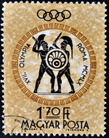 ancient olympic games: HUNGARY - CIRCA 1960: A post stamp printed in Hungary shows gladiators, devoted Olympic games in Rome,  circa 1960