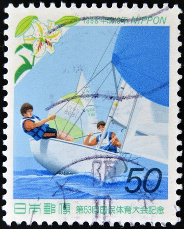 JAPAN - CIRCA 1998: A stamp printed in Japan dedicated to The 53rd National Sports Festival, shows a boat race, circa 1998 Stock Photo - 13874821
