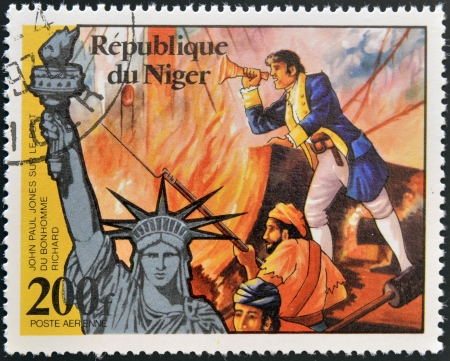 NIGER - CIRCA 1976: A stamp printed in Niger shows john paul jones and statue of liberty, circa 1976  Stock Photo - 13877190