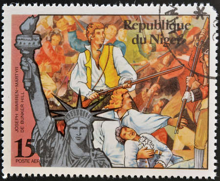 NIGER - CIRCA 1976: A stamp printed in Niger shows Joseph Warren, martyr of Bunker Hill and statue of liberty, circa 1976 Stock Photo - 13874845