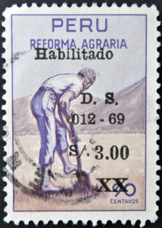 agrarian: PERU - CIRCA 1969: A stamp printed in Peru dedicated to agrarian reform, shows a farmer punching a hole with a shovel, circa 1969 Stock Photo