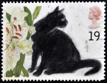 UNITED KINGDOM - CIRCA 1995: A stamp printed in Great Britain shows the Black cat and Lilium, circa 1995 Stock Photo - 13874768