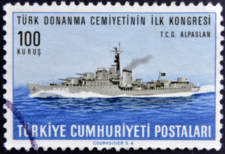 TURKEY - CIRCA 1965: A stamp printed in Turkey dedicated to First Congress of the marine community of turkey, shows T.C.G. Alpaslan, circa 1965 Stock Photo - 13874809