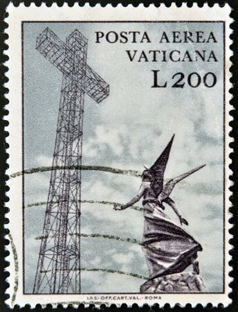 VATICAN - CIRCA 1970: A stamp printed in Vatican shows marble statue of angel and metal cross, circa 1970 Stock Photo - 13874867