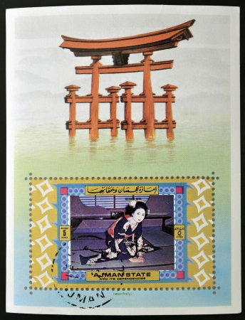 AJMAN - CIRCA 1980: A stamp printed in Ajman shows a geisha girl and Torii gate, circa 1980