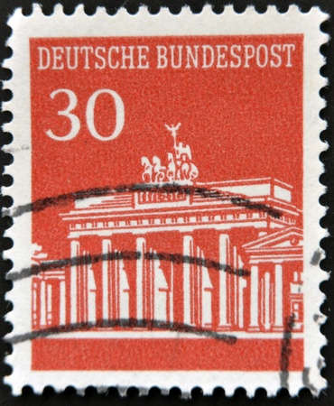 GERMANY - CIRCA 1967: A red stamp printed in Germany shows image of the Brandenburg Gate, circa 1967