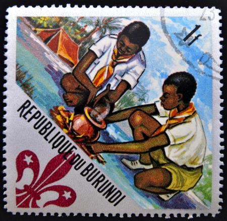 scouts: BURUNDI - CIRCA 1967: A stamp printed in Burundi shows Scouts preparing meal, circa 1967