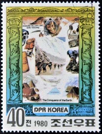 shri: DEMOCRATIC PEOPLES REPUBLIC (DPR) of KOREA - CIRCA 1980: A stamp printed in North Korea shows Edmund Hillary and Shri Tenzing, series The Conqueror of Eath, circa 1980
