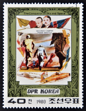 whittle: DEMOCRATIC PEOPLES REPUBLIC (DPR) of KOREA - CIRCA 1980: A stamp printed in DPR Korea shows Secondo Campini and Frank Whittle and their plane, from series The Conqueror of Sky and Space, circa 1980