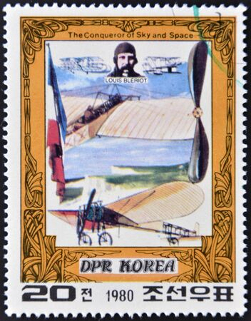DEMOCRATIC PEOPLES REPUBLIC (DPR) of KOREA - CIRCA 1980: A stamp printed in North Korea shows Louis Bleriot and his plane, one stamp from series The Conqueror of Sky and Space, circa 1980