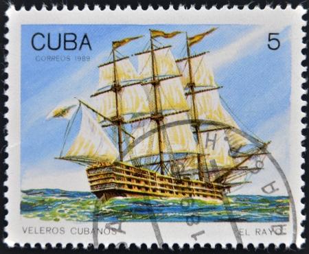 CUBA - CIRCA 1989: A Stamp printed in Cuba shows image of Cubans sailing, El Rayo, circa 1989  Stock Photo - 14137186