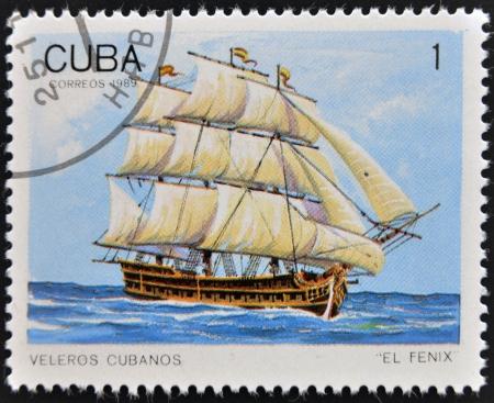 CUBA - CIRCA 1989: A Stamp printed in Cuba shows image of Cubans sailing, El Fenix, circa 1989  Stock Photo - 14137180