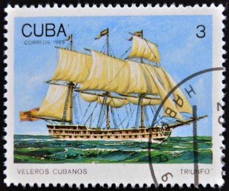 CUBA - CIRCA 1989: A Stamp printed in Cuba shows image of Cubans sailing, Triunfo, circa 1989  Stock Photo - 14137118