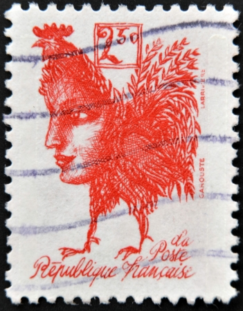 FRANCE - CIRCA 1992: A stamp printed in France commemorating the bicentennial of the French Republic, shows a gallic rooster with the face of Marianne, circa 1992