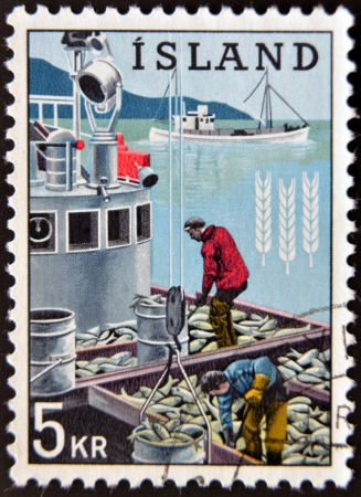 ICELAND - CIRCA 1963: A stamp printed in Iceland dedicated to global campaign against hunger shows fishermen, circa 1963  Stock Photo - 14137198