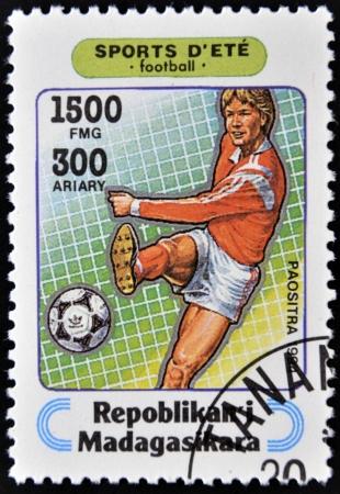 adidas: MADAGASCAR - CIRCA 1994  A stamp printed in Madagascar dedicated to summer sports shows  football, circa 1994  Editorial