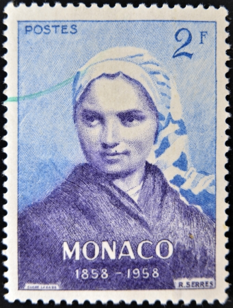 MONACO - CIRCA 1958: A stamp printed in Monaco shows a Bernadette Soubirous from series