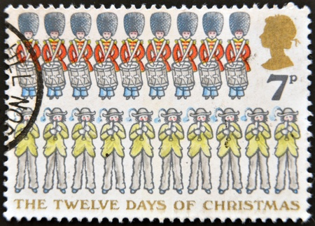 UNITED KINGDOM - CIRCA 1977: A stamp printed in the Great Britain shows Nine Drummers Drumming and Ten Pipers Piping, the Twelve Days of Christmas, circa 1977  Stock Photo - 14137213