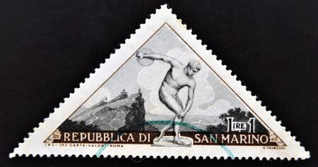 SAN MARINO - CIRCA 1953: A stamp printed in the San Marino, the sculpture depicts discus thrower, circa 1953  Stock Photo - 14137172