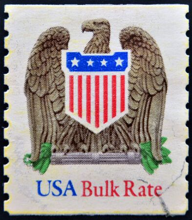 UNITED STATES OF AMERICA - CIRCA 1991: A stamp printed in USA shows eagle and shield, bulk rate, circa 1991