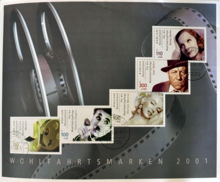 GERMANY - CIRCA 2001  Collection stamps printed in Germany dedicated to cinema, shows Greta Garbo, Marilyn Monroe, Charles Chaplin and roll of film, circa 2001