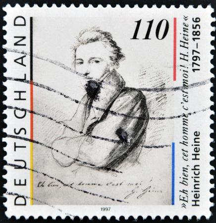essayist: GERMANY - CIRCA 1997  A stamp printed in Germany shows Heinrich Heine, circa 1997 Editorial