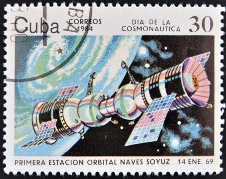 space station: CUBA - CIRCA 1984  A stamp printed in Cuba shows first space station, Soyuz spacecraft, circa 1984   Stock Photo