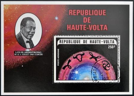 louis armstrong: REPUBLIC OF UPPER VOLTA, BURKINA FASO - CIRCA 1974  A stamp printed in Republic of Upper Volta shows Louis Armstrong and the constellation of Cancer, circa 1974 Editorial