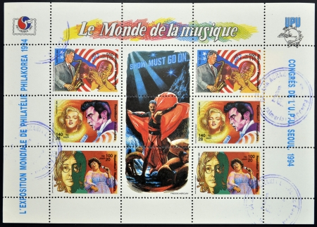 MADAGASCAR - CIRCA 1994  Collectin stamps dedicated to the world of music, shows Marilyn Monroe, Elvis Presley, Bill Clinton, Louis Armstrong, John Lennon and Ella Fitzgerald, circa 1994 Stock Photo - 14144531