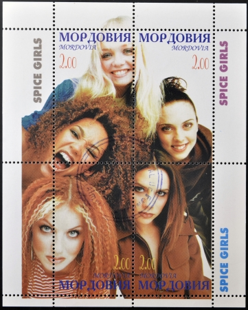 moldova: MOLDOVA - CIRCA 2000  A stamp printed in Moldova shows spice girls, circa 2000  Editorial