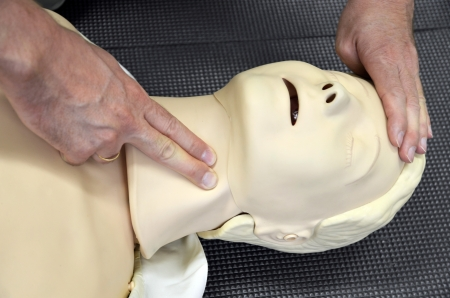 First aid medical practice mannequin or dummy, Check pulse on neck  photo