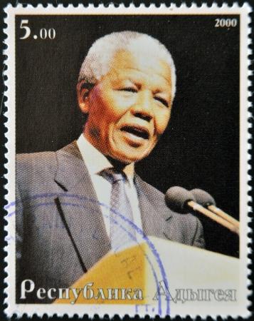 mandela: ABKHAZIA - CIRCA 2000   Stamp printed in Abkhazia shows portrait Nelson Rolihlahla Mandela, circa 2000 Editorial