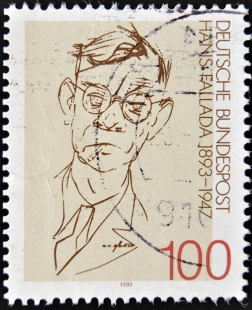 pseudonym: GERMANY - CIRCA 1993  A stamp printed in Germany shows to  Rudolf Friedrich Wilhelm Ditzen    Hans Fallada , circa 1993 Stock Photo