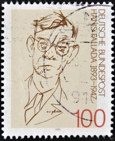 pseudonym: GERMANY - CIRCA 1993  A stamp printed in Germany shows to  Rudolf Friedrich Wilhelm Ditzen    Hans Fallada , circa 1993 Stock Photo