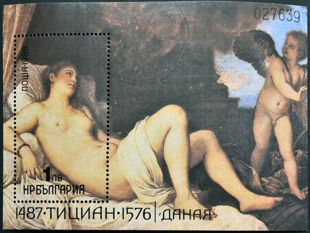 BULGARIA - CIRCA 1986  A stamp printed in Bulgaria shows Titian Vecelli  Tiziano Vecellio  painting, Danae receiving the shower of gold,  circa 1986   Stock Photo - 14288254
