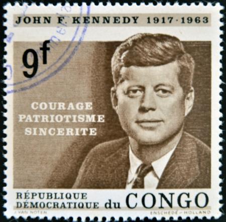 콩고 - -1964 년경 콩고에서 인쇄하는 스탬프 1964 년경, 존 F 케네디를 보여줍니다 에디토리얼