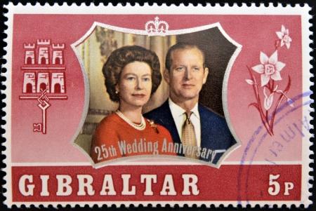queen elizabeth ii: GIBRALTAR - CIRCA 1972  A stamp printed in Gibraltar shows portrait of the Duke of Edinburgh and Queen Elizabeth II commemoracion of its silver wedding, circa 1972 Editorial