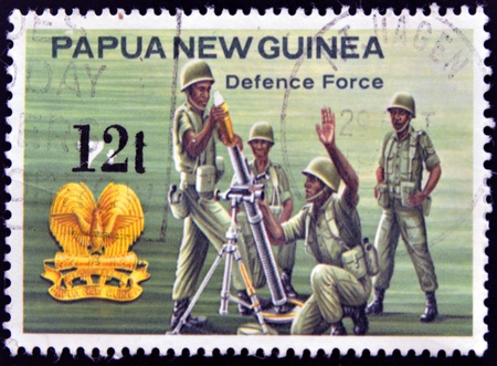 PAPUA NEW GUINEA - CIRCA 1981  A stamp printed in Papua New Guinea shows to Defense force, circa 1981 Stock Photo - 14288101