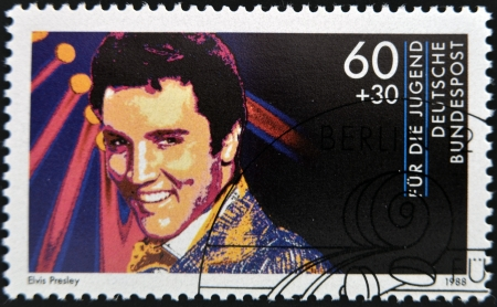 GERMANY - CIRCA 1988: A stamp printed in Germany shows image portrait of famous American singer Elvis Presley, circa 1988.