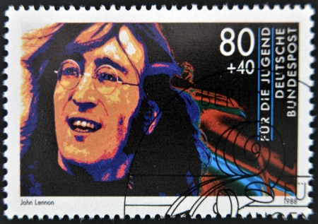 GERMANY - CIRCA 1988: A stamp printed in Germany shows image of John Lennon, circa 1988 Stock Photo - 14423814