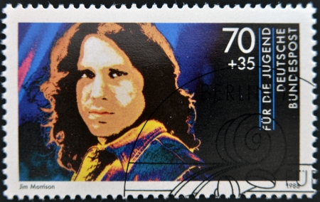 morrison: GERMANY - CIRCA 1988: A stamp printed in Germany shows image of Jim Morrison, circa 1988 Editorial