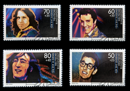 GERMANY - CIRCA 1988: Collection stamps printed in Germany dedicated to rock and roll, shows John Lennon, Jim Morrison, Elvis Presley and Buddy Holly, circa 1988 Stock Photo - 14423827