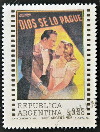 actress: ARGENTINA - CIRCA 1992: A stamp printed in Argentina dedicated to cinema shows poster for the film God bless, circa 1992