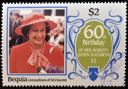 the majesty: BEQUIA - CIRCA 1986: A stamp printed in Grenadines of St. Vincent celebrating 60th birthday of her majesty Queen Elizabeth II, circa 1986