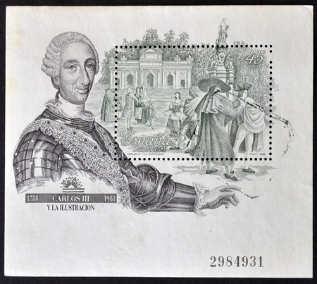 carlos: SPAIN - CIRCA 1988: A stamp printed in Spain shows King Charles III and a view of the Puerta de Alcala in Madrid, commemorates 200 years of the Enlightenment, circa 1988  Editorial
