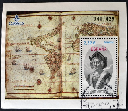 SPAIN - CIRCA 2006: A stamp printed in Spain shows a Cristobal Colom portrait and map the known world, commemorates the fifth centenary of his death. circa 2006