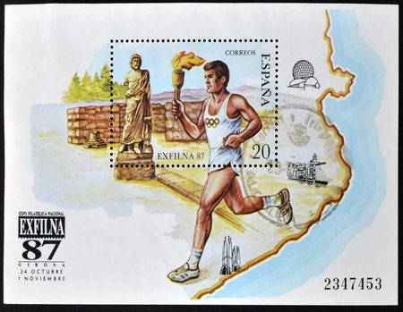 SPAIN - CIRCA 1987: A stamp printed in spain shows athlete with the Olympic torch, circa 1987