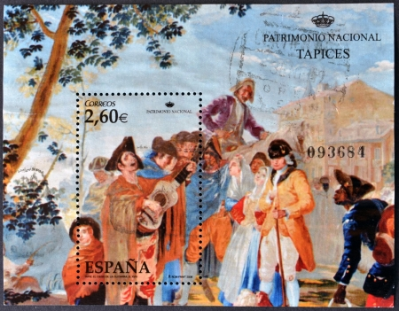 SPAIN - CIRCA 2008: A stamp printed in Spain shows  the tapestry entitled, The Blind Man of the guitar work of Goya, held at the Royal Tapestry Factory of Santa Barbara, circa 2008