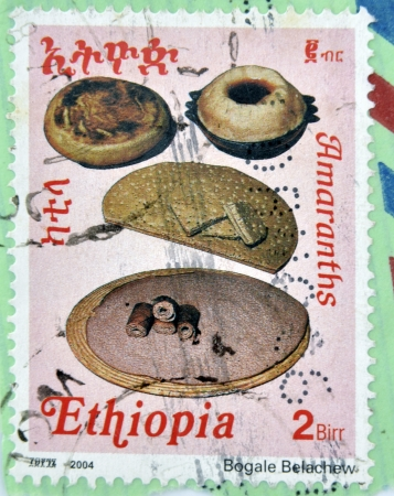 ETHIOPIA - CIRCA 2004 : A stamp printed in Ethiopia shows four types of traditional bread of Ethiopia, circa 2004 photo